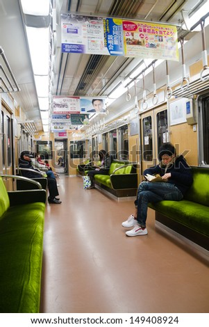 TOKYO, JAPAN - JANUARY 15: Interior of Oedo Line on January 15, 2013 in Tokyo, Japan. The line is Tokyo's first linear motor metro line. - stock photo