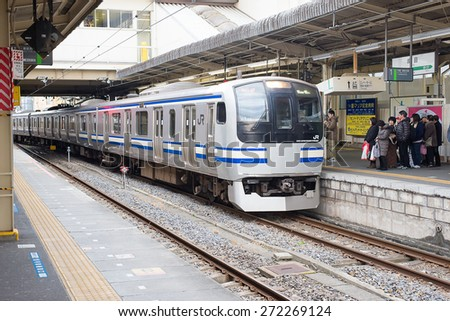 Tokyo, Japan -January 25, 2015:Queue for boarding the train.the train to narita airport at railway station.January 25, 2015. - stock photo