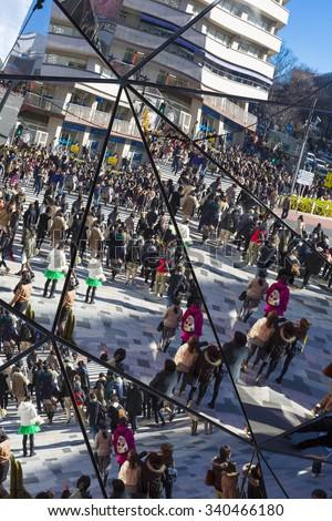 TOKYO, JAPAN, JANUARY 5: Reflection of the crowd into mirrors at shopping mall, busy crosswalk in Shibuya, Tokyo. Japan 2013 - stock photo