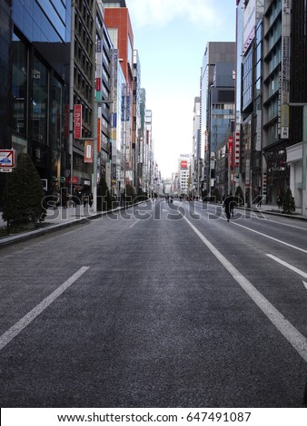 Tokyo, Japan. January 2015 - View of the shopping street at Ginza, Tokyo when the roads are closed for shopping on weekends