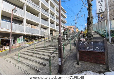 Tokyo, Japan - January 27, 2016:Yuyake dandan.it is the stairs on the slope road to Yanaka-Ginza street.view from the head of the stairs is popular. We can see Yanaka-Ginza street and beautiful sunset