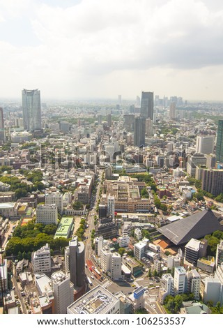 TOKYO, JAPAN-JULY 5: A view of Tokyo from the top of Tokyo Tower on the July 5, 2011 in Tokyo, Japan.  The tower has a height of 332.6 meters. And Tokyo has a population of 13,157,428 inhabitants.