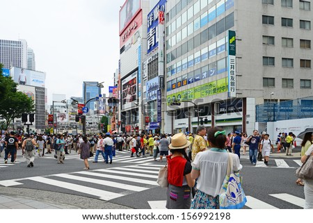 TOKYO, JAPAN - JULY 27: Crowds of people in the center of Shibuya in July 27 2013. It is the most popular commercial center in Tokyo, Japan.