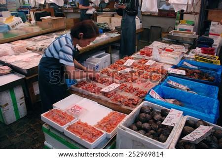 TOKYO, JAPAN - JULY 22 : Seafood sale at Tsukiji Market, the biggest wholesale market in Japan taken July 22, 2008 in Tokyo, Japan. - stock photo
