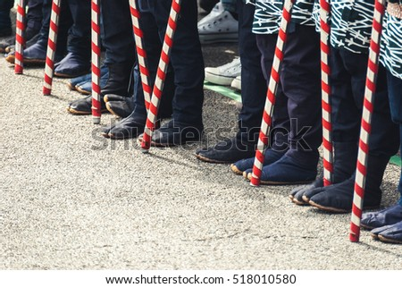 Tokyo, Japan - March 18, 2015: Detail shot of the traditional boots worn and sticks carried by children participating in the Golden Dragon Dance 'Kinryu no mai' at Senso-ji temple in Asakusa, Tokyo