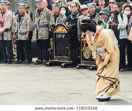 Tokyo, Japan - March 18, 2015: Geisha singing at the Golden Dragon Dance 'Kinryu no mai' at Senso-ji temple in Asakusa, Tokyo