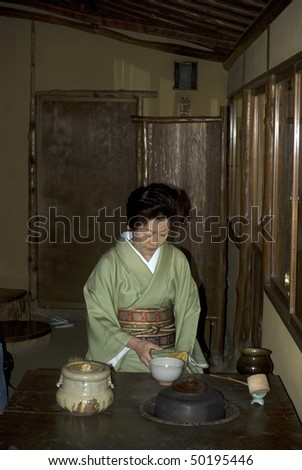 TOKYO, JAPAN - MARCH 30: Japanese lady in kimono is performing a traditional tea ceremony on March 30, 2010 in Tokyo, Japan - stock photo