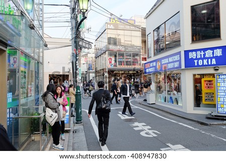 TOKYO JAPAN - March 30, 2016: People in Ura-Harajuku street. The area is world-famouse as the centre of fashion and culture for Japanese youth.  - stock photo