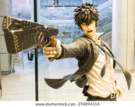 TOKYO; JAPAN - MARCH 30: Psycho-pass figures on March 30; 2015 in Tokyo; Japan. It is a Japanese anime television series that was produced by Production I.G, written by Gen Urobuchi. - stock photo