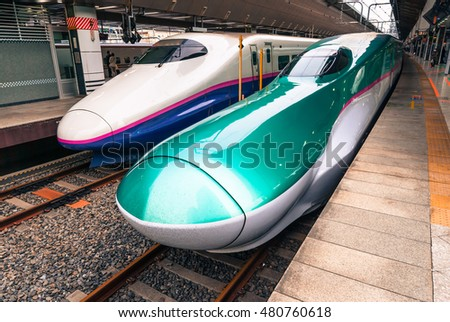 Tokyo, Japan - March 16, 2016: Series E5 and series E2 shinkansen 'bullet trains' waiting to depart at Tokyo station