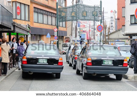 TOKYO, JAPAN-MARCH 30: Taxi waiting area near the kamakura station in Tokyo on MARCH 30, 2016 in Tokyo,Several taxi cabs are waiting in line along the sidewalk. - stock photo