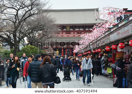 TOKYO, JAPAN - 10 March, 2016 : Tourists walk on Nakamise Dori is a street with food and souvenirs shops in Senso-ji shrine, Asakusa - stock photo