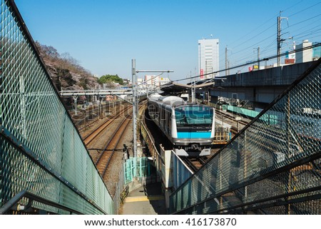 Tokyo, Japan - MARCH 30, 2016: Train Sits in a Railway Station in Tokyo