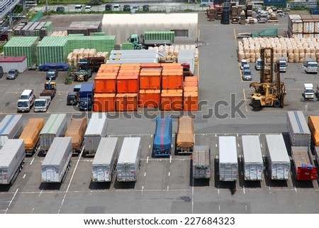 TOKYO, JAPAN - MAY 11, 2012: Containers in Port of Tokyo in Tokyo. Port of Tokyo is one of busiest seaports in the Pacific Ocean basin with 100 million tonnes of cargo handled annually.