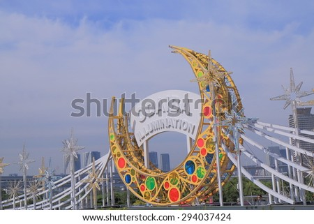 TOKYO JAPAN - MAY 22, 2015: Odaiba illumination monument. Odaiba is a large artificial island in Tokyo Bay and a popular tourist destination.   - stock photo