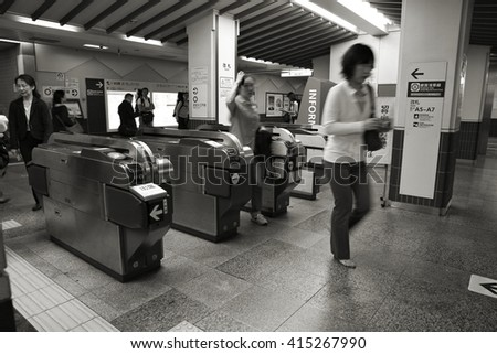 TOKYO, JAPAN - MAY 8, 2012: People enter Tokyo Metro on May 8, 2012 in Tokyo. With more than 3.1 billion annual passenger rides, Tokyo subway system is the busiest worldwide. - stock photo