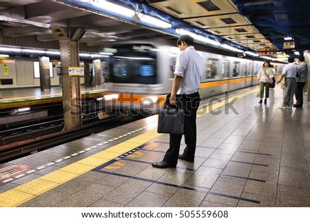 TOKYO, JAPAN - MAY 8, 2012: People wait at Tokyo Metro station in Tokyo. With more than 3.1 billion annual passenger rides, Tokyo subway system is the busiest worldwide.