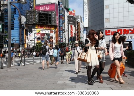 TOKYO, JAPAN - MAY 11, 2012: People walk in Shinjuku district of Tokyo. Tokyo is the capital city of Japan and the most populous metropolitan area in the world with almost 36 million people.
