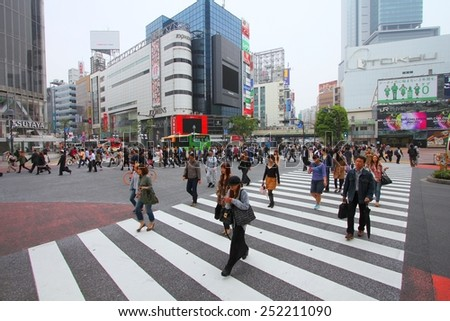 TOKYO, JAPAN - MAY 9, 2012: People walk the famous crossing in Shibuya, Tokyo. Shibuya crossing is one of busiest places in Tokyo and is recognized thanks to being featured in multiple films. - stock photo