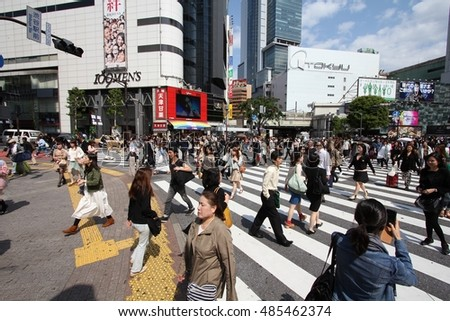 TOKYO, JAPAN - MAY 11, 2012: People walk the Hachiko crossing in Shibuya, Tokyo. Shibuya crossing is one of busiest places in Tokyo and is recognized thanks to being featured in multiple films.