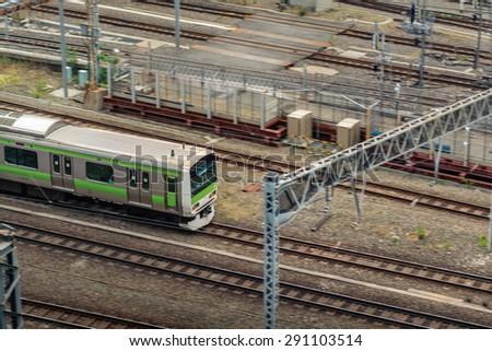 TOKYO,JAPAN - 9 May 2015 :Trains are a very convenient way for visitors to travel around Japan .About 70 percent of Japan's railway network is owned and operated by the Japan Railways (JR). - stock photo