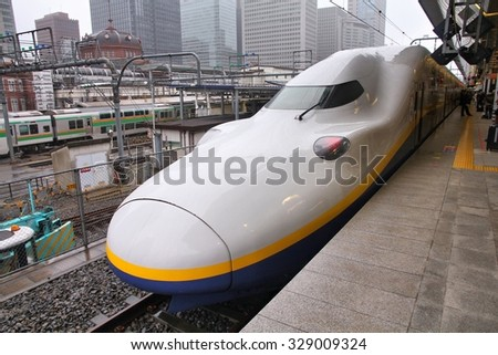 TOKYO, JAPAN - MAY 4, 2012: Travelers board Tohoku Shinkansen E4 series train at Tokyo Station. Hayate has top operating speed of 275km/h and is among fastest trains worldwide.