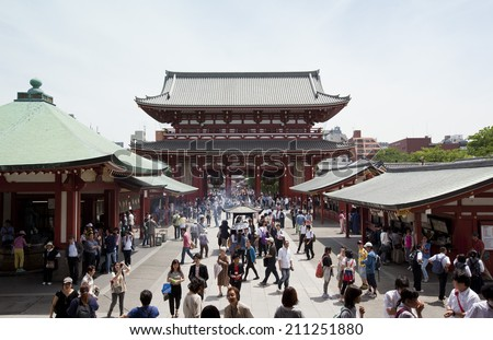 TOKYO,JAPAN - MAY 28 :Unidentified tourists in the Senso-ji Temple on May 28,2014 in Tokyo,Japan.The Senso-ji Buddhist Temple is the symbol of Asakusa and one of the most famed temples in all of Japan - stock photo