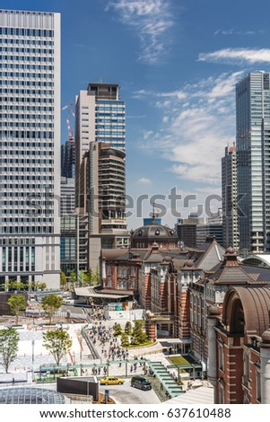 TOKYO, JAPAN - MAY 5: urban view with the Tokyo Station building and construction works in the square nearby located in the Marunouchi business district of Chiyoda on May 5, 2017.