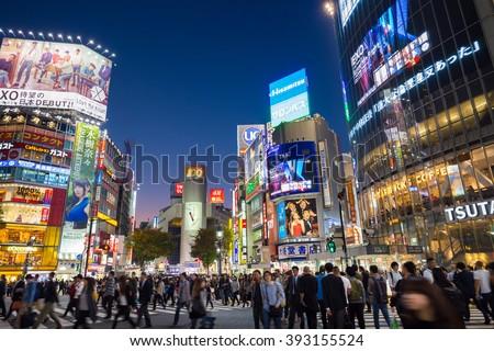 Tokyo, Japan - Nov 6: Pedestrians cross at Shibuya Crossing on November 6th in Tokyo, Japan, 2015 . Shibuya Crossing is one of the busiest crosswalks in the world. - stock photo