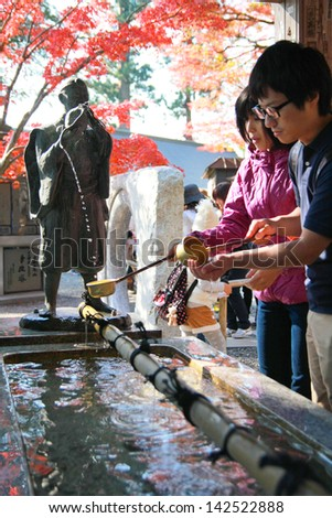TOKYO,JAPAN - NOV 23: People washing the hand before entering to the temple at Mt.Takao in Kanto area nearby Tokyo ,Japan on November, 23, 2011