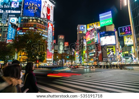 Tokyo, Japan, Nov 17, 2016: Shibuya Crossing Of City street with crowd people on zebra crosswalk in Shibuya town. Shibuya is a special ward located in Tokyo for shopping at night.