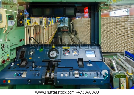 TOKYO, JAPAN - NOVEMBER 28 2015:  Interior of control cabin with dashboards on a Japanese train
