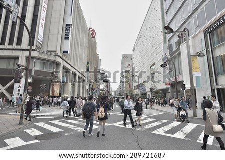 TOKYO, JAPAN - NOVEMBER 02, 2014: Many People walk in Shinjuku district of Tokyo. Tokyo is the capital city of Japan and the most populous metropolitan area in the world with almost 36 million people.