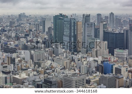 TOKYO, JAPAN - NOVEMBER 25, 2015: Tokyo city skyscrapers, high - rise and industrial buildings  - view from above on a cloudy day. - stock photo
