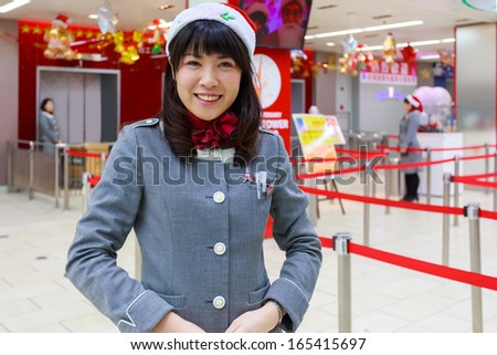 TOKYO, JAPAN - NOVEMBER 25: Tokyo Tower's female officer in Tokyo, Japan on November 25, 2013. Unidentified female officer in Tokyo Tower prepare for the 55th anniversary and the coming of Christmas