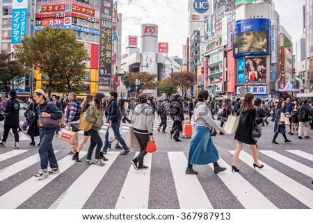 Tokyo, Japan - November 21, 2015: Unidentified pedestrians walk at Shibuya Crossing, one of the busiest crosswalks in the world in  Tokyo, Japan.