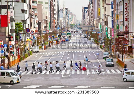 TOKYO, JAPAN - OCT 27, 2014: People walking through Asakusa district in Tokyo, Japan. - stock photo