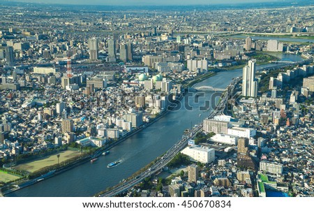 Tokyo, Japan - October 10, 2015: : Aerial view towards Asakusa district and Sumida River. commercial and residential building, road aerial view. The view of Tokyo city from top level of Tokyo Sky Tree