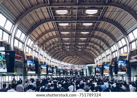 Tokyo, Japan, October 2017: Japanese corporate workers going to work at rush hour in subway station in Tokyo main office buildings area