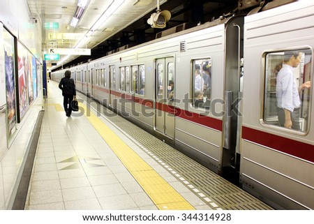 TOKYO, JAPAN - OCTOBER 6, 2015: Passenger in Metro station, Hibiya line. It is a popular mode of transport in Tokyo, Japan. October 6 2015 - stock photo