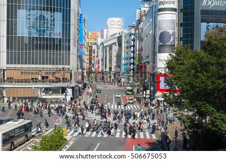 TOKYO/JAPAN - OCTOBER 24, 2016: Shibuya scramble crossing during the day. Shibuya station is one of Tokyo's busiest railway stations.
