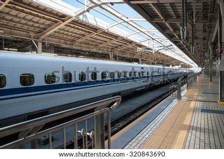 TOKYO, JAPAN - OCTOBER 24: Shinkansen in Tokyo, Japan on October 24, 2014. Japan's main islands, are served by a network of high speed train lines that connect Tokyo with most of the major cities. - stock photo