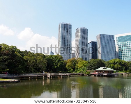 TOKYO, JAPAN - SEP 28: Hamarikyu Gardens in Tokyo, Japan on September 28, 2015. Tokyo is both the capital and largest city of Japan.