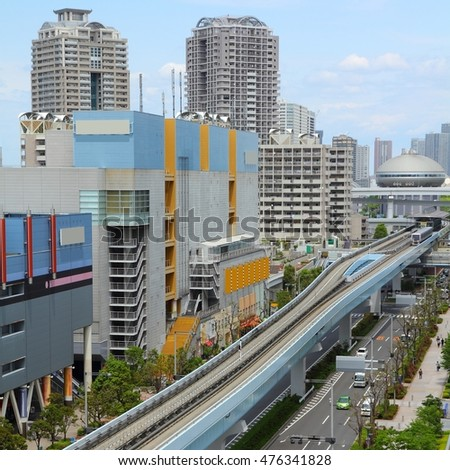 Tokyo, Japan - skyline of Odaiba district with streets and elevated monorail