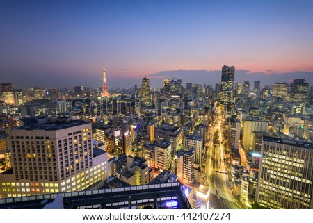 Tokyo, Japan skyline over Shiodome district towards Tokyo Tower. - stock photo