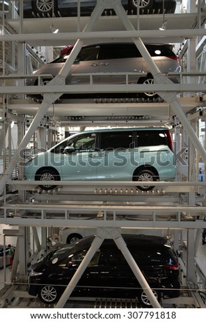 TOKYO - JULY 31, 2015: an automated multi-story car parking system. Automatic multi-story car park systems enable to optimize space in crowded cities.