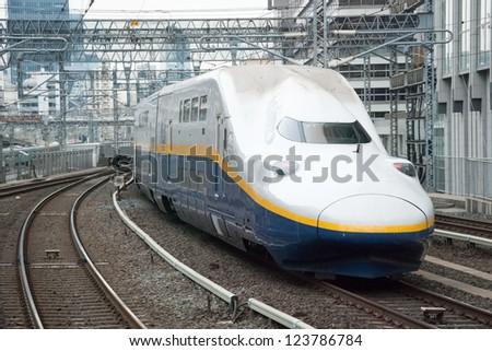 TOKYO - JUNE 2, 2012: Shinkansen bullet train at Tokyo station in June 2, 2012 Tokyo,Japan.Shinkansen is world's busiest high-speed railway operated by four Japan Railways group companies - stock photo