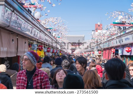 TOKYO - March 28 2015 : Nakamise shopping street in Asakusa connect to Senso-ji Temple in Asakusa,  Tokyo on 28 March 2015.The Senso-ji Temple in Asakusa is the most famous temple in tokyo. - stock photo