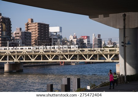 TOKYO - March 28, 2015 : View of The Sumida River at daytime , The Sumida River is a river which flows through Tokyo on March 28, 2015 in Tokyo Japan - stock photo