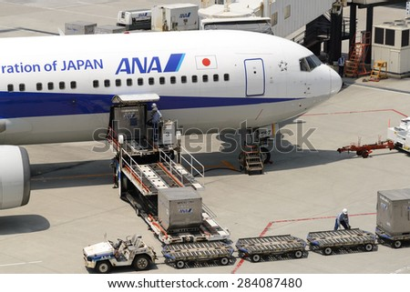 TOKYO - MAY 9: ANA aircraft at Narita Airport on May 9, 2015 in Tokyo. ANA is one of largest airlines of Japan with 177 passenger planes. - stock photo